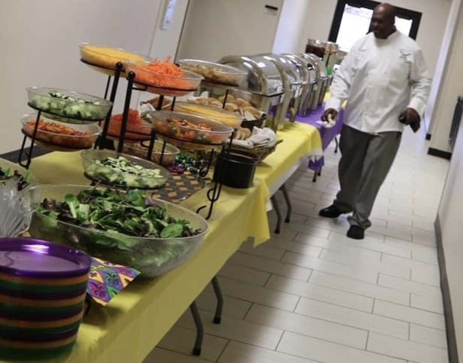 Chef Travis final details on buffet catering