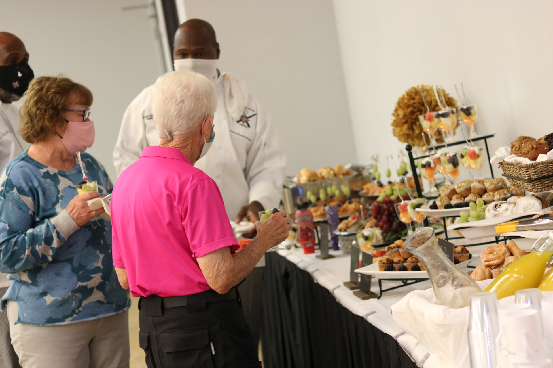 Executive chef helping serve guest at breakfast